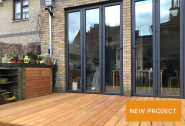 Replacement of decking and cladding  in Hackney Garden